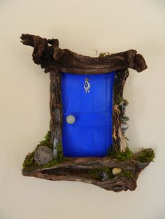 Sedona Fairy Doors.  Kokopelli Door with quarts crystals.  Whimsical twisting wood representing the beauty and vortex energy of Sedona!  Peace and Magic!  sedonafairydoors.etsy.com