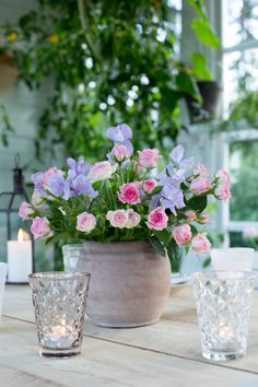 Sweet peas and roses in a vase