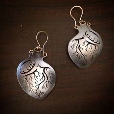 Forward hanging anatomical heart earrings by Luana Coonen. 14k, sterling silver.