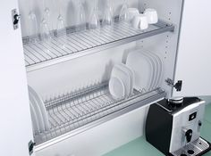 Dish rack cupboard above your sink... I have seen ones which does not have the bottom section of the cupboard so the water is free to fall straight back into the sink... Makes doing the dishes so much easier... No drying, and no having to put them away... INGENIOUS