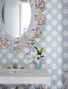 A Phillip Jeffries wallcovering continues the home's blue-and-white palette into the powder room. - Photo: Jean Allsopp / Design: Mary McWilliams and Kenson Bates