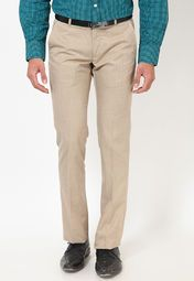 Let the good time roll adorning these beige coloured formal trousers from the house of Arrow. Made from poly viscose, these slim-fit trousers are designed to enhance the appeal of your toned legs. Flaunt your best bib and tucker as you adorn these formal trousers with a crisp shirt and a pair of butterfly loafers.
