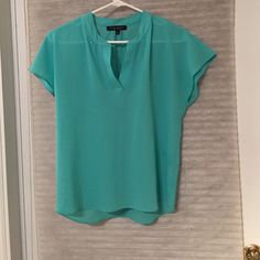 Torquiose blouse Turquoise sheer blouse. Size small. 100% polyester. By Green Envelop. Open to best offers, but please submit an offer. I prefer not to negotiate in the comments section. No trades please. Tops Blouses