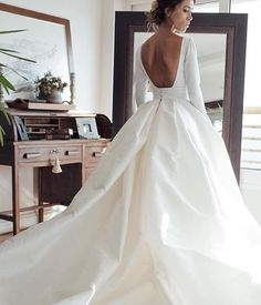 The dress manages to be simple and dramatic all at once - it's the skirt and the cut to the back. I think it would be perfect for a princess.