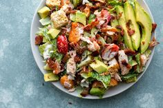 Salmon BLT Salad--A salad so flavorful and satisfying you'll forget it all started with lettuce. The combination of salmon, bacon, and avocado is unbelievable and the homemade creamy dressing completes the whole dish!