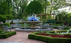 The lovely Parterre Garden is visible beyond the Rose Garden plantings.