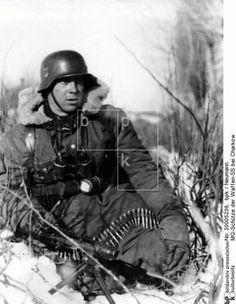 A German machine-gunner at Kharkov, Russia. 1943.