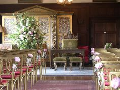 The aisle decorated with pink peonies at Ramster Hall wedding veneu in Surrey