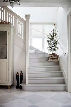 Simple Christmas house. Wondering how many times that tree would get knocked over on my staircase...