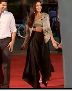 Katrina Kaif in an Anamika Khanna outfit - an emblazoned cape top teamed up with a black dhoti-palazzo pants (video) Dhoti Pants For Men, Pants For Women, Clothes For Women, Indian Dresses, Indian Outfits, Indian Clothes, Black Palazzo Pants, Reception Gown, Anamika Khanna