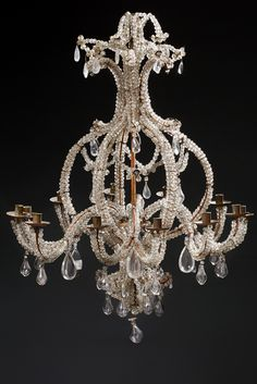 "Chandelier basket called ""Lace"" at twelve lights. It is fully embellished with faceted beads, pendants, almonds, flowers and stylized molded carved crystal, blown glass bulbs. eighteenth century. (Mounted electricity)"