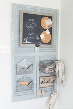 Trash to Treasure! This blogger took a pair of chippy old shutters and turned them into a functional and beautiful rustic wall organizer for her family. http://www.tableandhearth.com