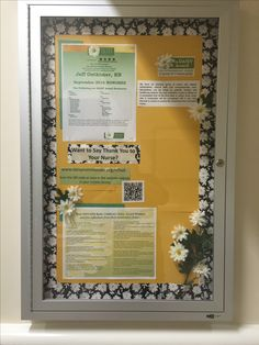 Daisy bulletin board at the front of our unit. Honoring nurses.
