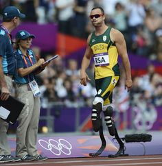 London 2012 Emotional Moments - Day 13: South Africa's Oscar Pistorius looks dejected as he leaves the track while competing in the men's 4X400m relay heats. Pistorius' team did not finish the heat after a Kenyan runner collided with South Africa's Ofentse Mogawane, but the International Association of Athletics Federations said that the South African team would compete in the finals.  (Photo: Adrian Dennis / AFP - Getty Images) #NBCOlympics