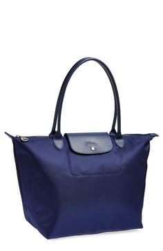 The iconic Longchamp Le Pliage in all navy - love that the straps are navy too.