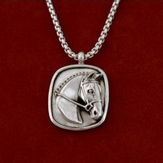 "Sterling silver hunter/jumper frame pendant measures 1 x 1 1/4"" on 18"" or 20"" sterling silver rolo necklace."