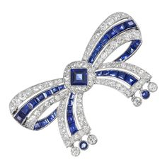 Important CARTIER Art Deco Diamond and Sapphire Bow Pin
