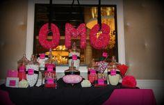 Candy Bar with assorted pink candy, pink carnation letters above