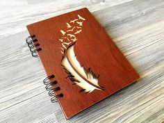 This unique wooden notebook with feather and birds is great for jotting down your thoughts, ideas, goals, to do lists, etc.  We made this beautiful wood journal for a person who still love to write and draw their thoughts with a pen and paper. And we know how good it feels. But how would it feel to have absolutely personalized engraved pad? We checked – it's also good. So If you love using personal custom journal instead of apps or you know someone who does – this stuff will make a perfect…
