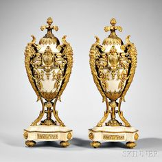 Pair of Louis XVI-style Ormolu-mounted Marble Urns, 19th century.