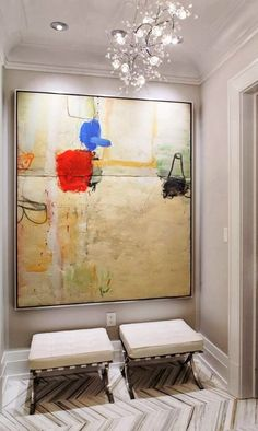 This large painting could look great with a wider frame, but this narrow float is the perfect choice for the limited space where it is displayed.