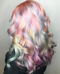 Captivating curls on pastel perfect locks !! This hair goddess is flaunting a beautiful mix of colors for a stunning summer 'do.  :…