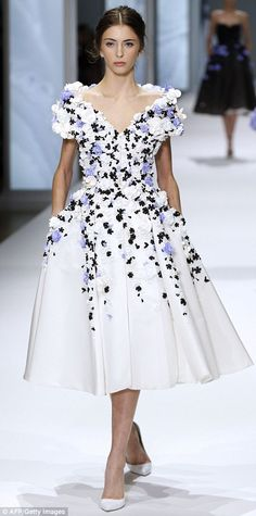 The designers at Ralph & Russo were inspired by the 'goddess of spring' with detail such as blue and white petal appliqué and pearl embroidery sewn to Fifties-style dresses and flirty tulle-lined strapless dresses