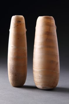 Ancient Egyptian Banded Alabaster Oil Vessels, Egypt, 1069 BC to 747 BC  These vessels contained oils and other unguents that had been perfumed with various aromatic herbs and spices, for use on the living body or as sacred oils to anoint the mummy in the tomb at various stages of the ritual 'opening of the mouth' ceremony. From early Dynastic period onwards alabaster was increasingly used for the production of cosmetic and funerary vessels