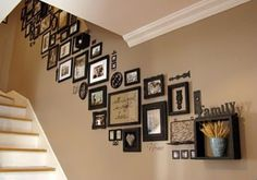 picture frames grouped along staircase