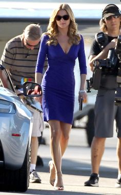 Revenge star Emily VanCamp is strikingly gorgeous in this royal blue dress and classy rounded sunnies. She has great legs!