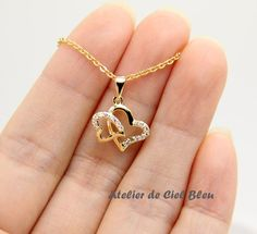 Double Heart Necklace by AtelierdeCielBleu Double Heart Necklace, Heart Shaped Necklace, Gold Mangalsutra Designs, Gold Earrings Designs, Gold Chain Design, Gold Jewellery Design, Girls Jewelry, Heart Jewelry, Locket Design