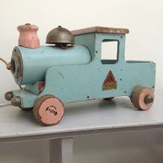 .blue wooden train engine