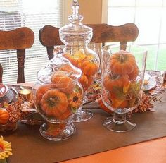 I like the idea of having this large glass vases out all the time and filling them with seasonal items.