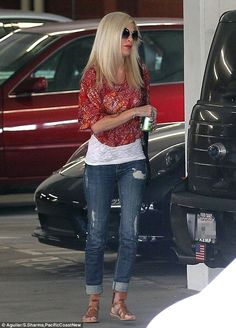 Back into the world: Tori Spelling stepped out for the first time since her husband Dean McDermott was admitted into rehab for sex addiction...