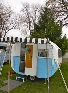 Poppytalk: 25 of the Cutest Campers Ever! A cute black and white awning goes perfectly with this 8 foot Starlette out of New Zealand. | Vintage Caravan Magazine