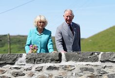 Camilla Parker Bowles Photos - Prince Charles, Prince of Wales and Camilla, Duchess of Cornwall walk across the bridge in Aberdaron during a visit to the Welsh Village on July 5, 2016 in Aberdaron, England. The Prince Charles, Prince of Wales and Camilla, Duchess of Cornwall are on the second day of their annual visit to Wales. - Prince Of Wales & Duchess Of Cornwall's Annual Summer Visit To Wales