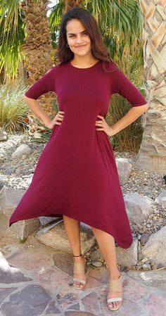Feel like you are walking on air in our Swept Away Burgundy Red High-Low Maxi Dress. Super soft and stretchy jersey knit shapes a rounded neckline, relaxed fit bodice, three quarter long sleeves, and flowy hi low maxi skirt. Halter maxi dresses, short sleeve maxi dresses, off the shoulder maxi dresses, there is a maxi dress for everyone and every style of Maxi Dresses has it's perks! #hilowdress