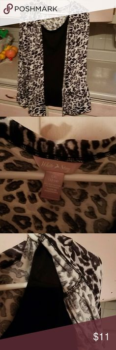 Black shirt with leopard cover. Attached. Excellent condition. No flaws. Long sleeves with a little pleating at ends of sleeves. White Stag Tops Blouses
