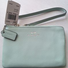 """NWT Coach Light Teal """"Seaglass""""Corner Zip Wristlet ♦️PRICE REDUCED AND IS FIRM♦️Crossgrain leather. Inside multifunction pocket. Zip closure, fabric lining. Wrist strap is attached. Care instructions, Coach tissue and gift box are included. Measures about 6 1/4 (L) x 4 (H). Beautiful teal/ green pastel color with Silver accents. Perfect for Spring. PRICE IS FIRM. NO TRADES.  Coach Bags Clutches & Wristlets"""