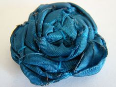 The loosely twisted lolly pop fabric flower