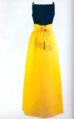 Jacqueline Kennedy wore this black silk velvet and Chinese yellow silk satin evening dress by Chez Ninon for a White House state dinner honoring President Manuel Prado ofPeruon September 19, 1961.