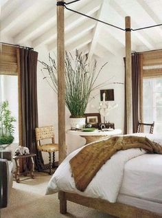 white walls, camel and white bedding, bamboo blinds, exposed beams, Contemporary British Colonial design.