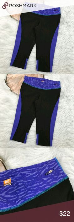 """Lucy Activewear Capri Yoga Pants Lucy Activewear black blue tech athletic crop pants. Womens size Small. Gently used, without flaws. See pictures for details.  Waist laying flat - 14"""" Rise - 8"""" Inseam - 17""""  Inventory 03122017 Lucy Activewear Pants"""