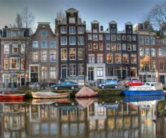 Ah, Amsterdam! I lived almost a year on a boat on the Amstel Canal in Amsterdam, Netherlands (Holland). Lots of good memories. Tour En Amsterdam, Visit Amsterdam, Amsterdam Travel, Amsterdam Netherlands, Amsterdam Canals, Amsterdam Houses, Amsterdam Living, Amsterdam Bar, Netherlands Tourism