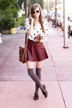Grey wool thigh high socks with burgundy leather skirt and white shirt with black circular pattern