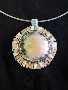 Warren and Robbin Moeller-Smith,   sterling silver, mammoth ivory, enameled copper