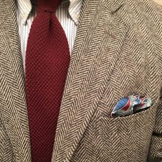 Light grey tweed jacket, white shirt with light blue dress stripes, red knit tie
