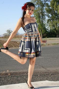 This Tomi Girl dress was made by Lakota designer Mildred High Elk Carpenter, out of a Pendleton blanket, for her MILDJ Native Fashion line. It's worn by N8tv Dyme's top model Katrina Drust. Photo by Tiara Carpenter, Native Doll Photography, Bellingham, Wa.