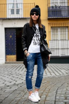 black bomber jacket + white graphic shirt + boyfriend jeans + white converse sneakers