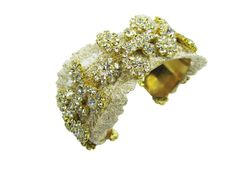 Simple & elegant touches of gold for a statement bridal cuff.  See more here: http://www.cloenoeldesigns.com